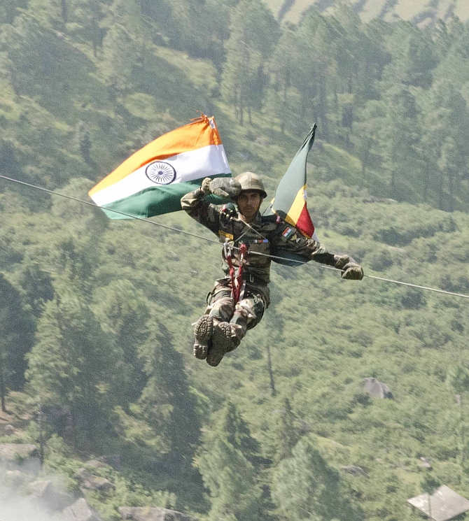 An Indian soldier with 12 Madras zip lines off a cliff Sept. 18, 2016, at Chaubattia Military Station, India. This was part of a rappelling and a skirmish order demonstration for U.S. and Indian soldiers during Yudh Abhyas 2016. Yudh Abhyas is a bilateral training exercise geared toward enhancing cooperation and coordination between the two nations through training and cultural exchanges. (U.S. Army photo by Staff Sgt. Samuel Northrup)
